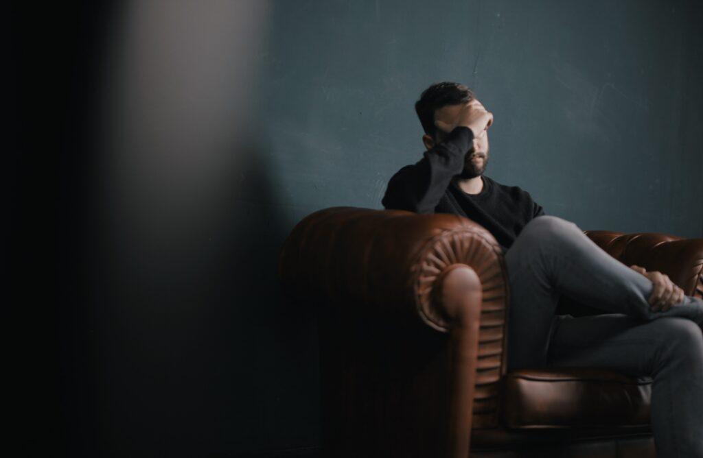 man-stressed-on-sofa